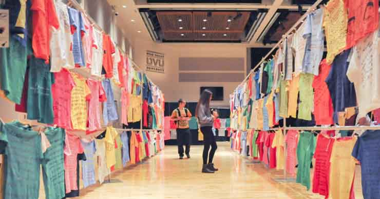 Visitors walking through the clothesline display